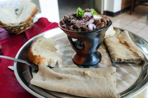Ethiopian food tibs on a plate with injera bread